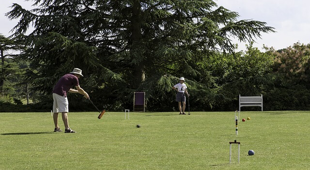 two man playing croquet